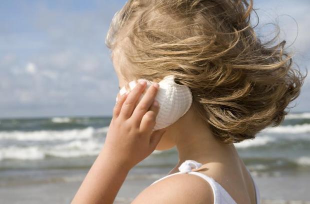 Girl listening to ocean